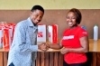 Googler presenting a gift to Bash Akinbami of Bashphotos